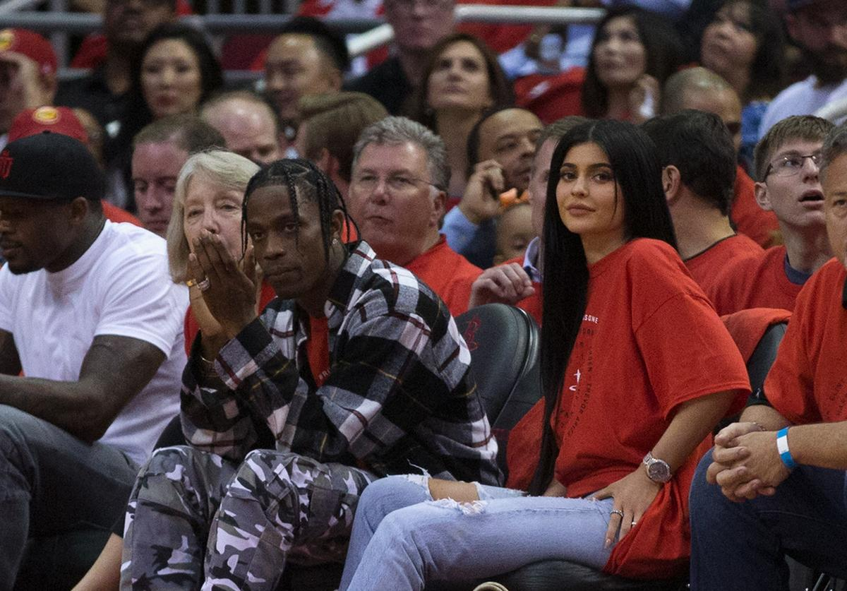 Houston rapper Travis Scott and Kylie Jenner watch courtside during Game Five of the Western Conference Quarterfinals game of the 2017 NBA Playoffs at Toyota Center on April 25, 2017 in Houston, Texas