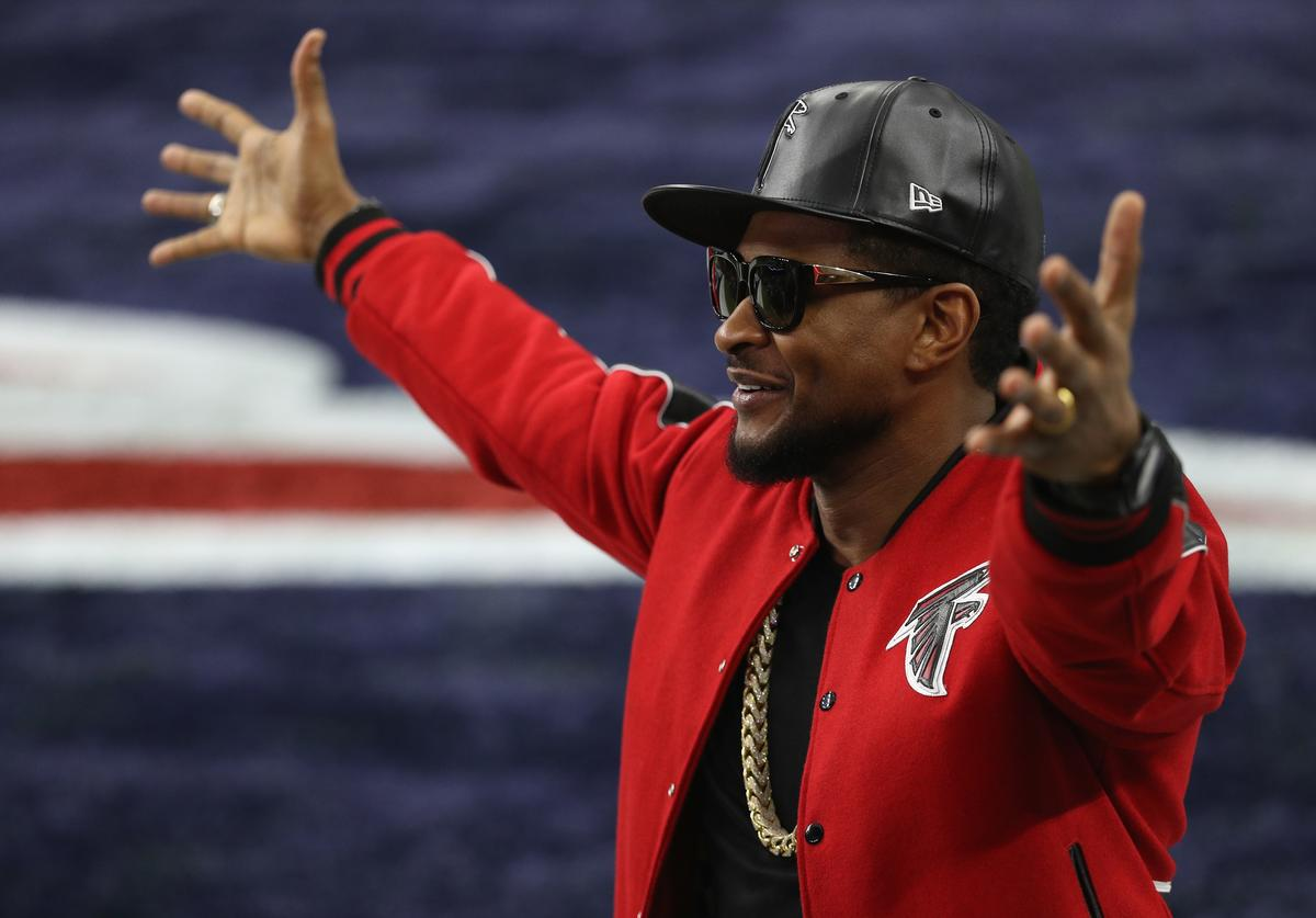 Usher looks on prior to Super Bowl 51 between the Atlanta Falcons and the New England Patriots at NRG Stadium on February 5, 2017 in Houston, Texas.