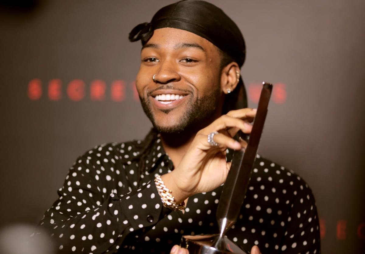 PartyNextDoor poses with the Secret Genius: R&B award during Spotify's Inaugural Secret Genius Awards hosted by Lizzo at Vibiana on November 1, 2017 in Los Angeles, California.