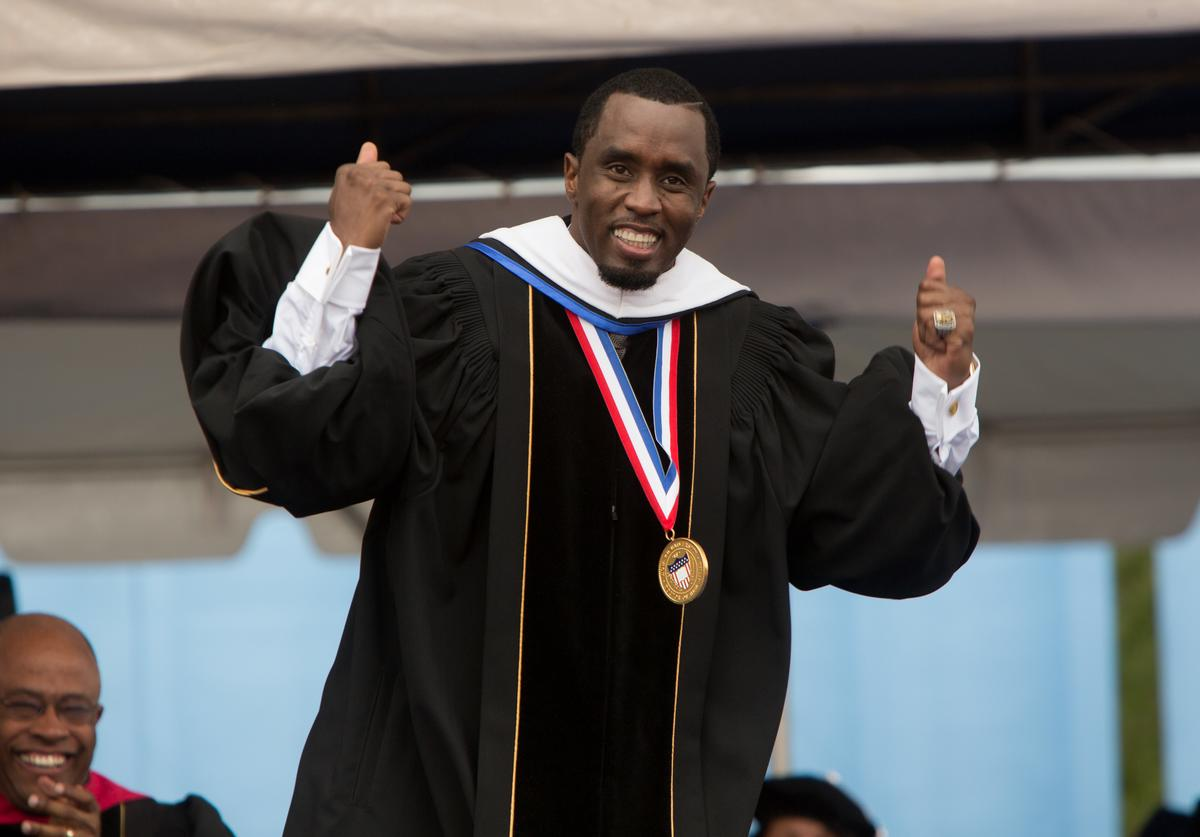 Entrepreneur and philanthropist Sean 'Diddy' Combs reacts after delivering the commencement speech at Howard University's 146th commencement exercises on May 10, 2014 in Washington, D.C. Also honored at the convocation were CNN anchor Wolf Blitzer, Chairman and CEO of PespiCo Indra K. Nooyi, professor of surgery Dr. Clive Callender, and jazz legend Benny Golson.