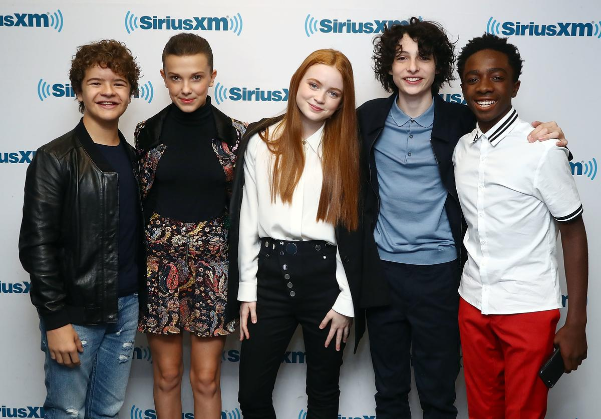 Actors Gaten Matarazzo, Millie Bobby Brown, Sadie Sink, Finn Wolfhard and Caleb McLaughlin attend SiriusXM's 'Town Hall' cast of Stranger Things on SiriusXM's Entertainment Weekly Radio on November 1, 2017 in New York City.