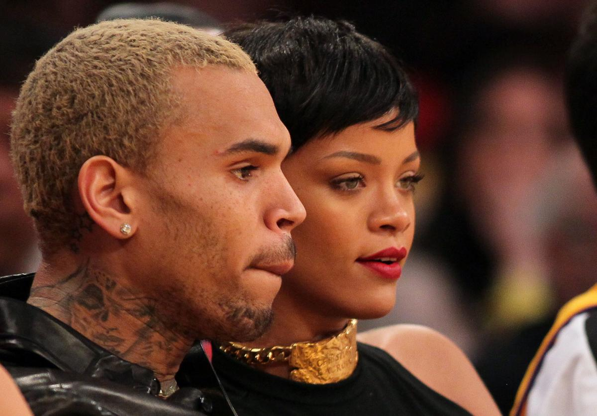 Chris Brown and Rihanna attend the NBA game between the New York Knicks and the Los Angeles Lakers at Staples Center on December 25, 2012 in Los Angeles, California