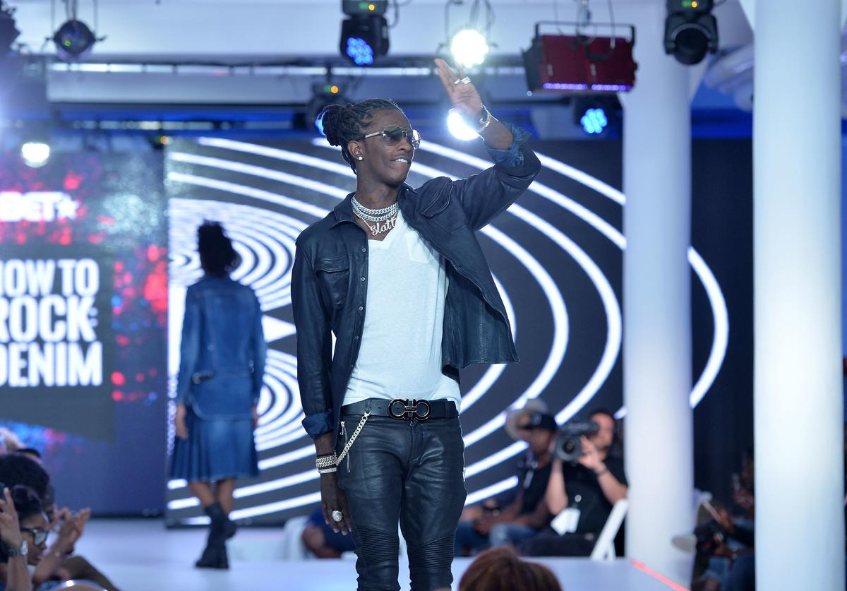 Young Thug greets the audience from the runway during the BET How To Rock: Denim show at Milk Studios on August 10, 2016