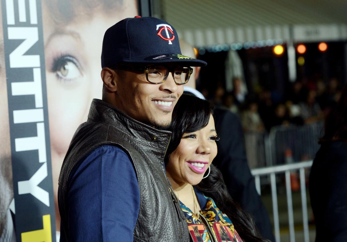 T.I. and his wife Tiny arrive at the premiere of Universal Pictures' 'Identity Thief' at the Village Theatre on February 4, 2013 in Los Angeles, California