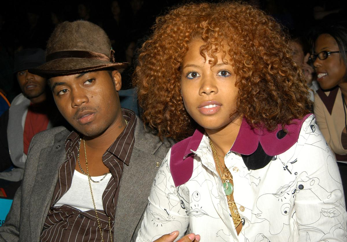 Rappers Nas (L) and Kelis appear at the Baby Phat Spring/Summer 2004 Collection fashion show September 13, 2003 in Bryant Park in New York City.