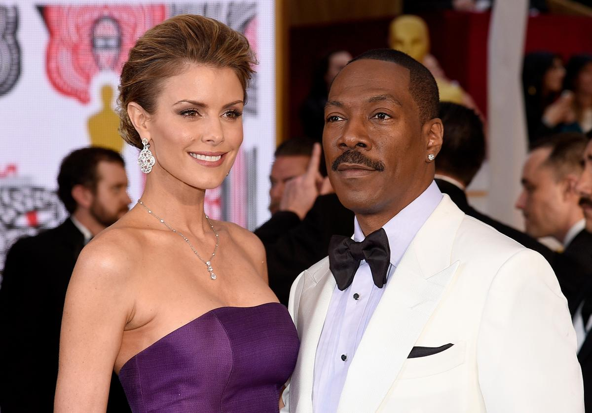 Eddie Murphy and model Paige Butcher at the 87th Annual Academy Awards