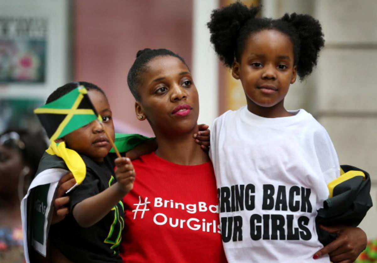Supporters calling for the release of schoolgirls abducted by Boko Haram Islamists protest outside the Nigerian embassy on May 17, 2014 in London, England.