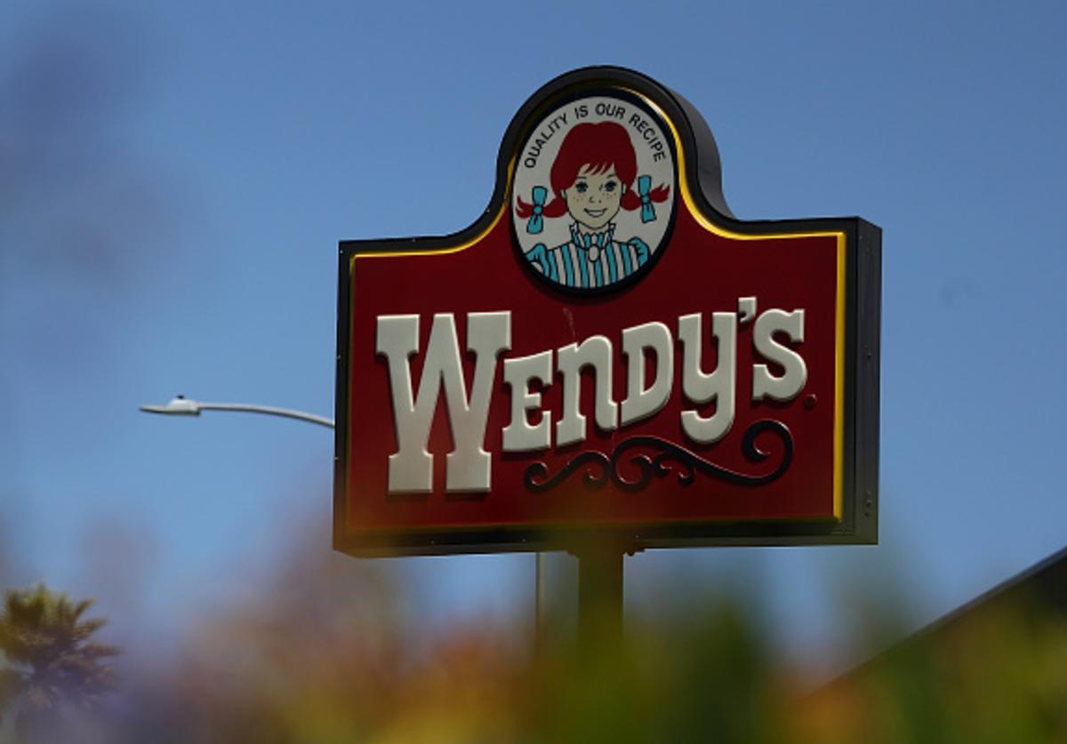 A sign is posted in front of a Wendy's restaurant on August 10, 2016 in Daly City, California.