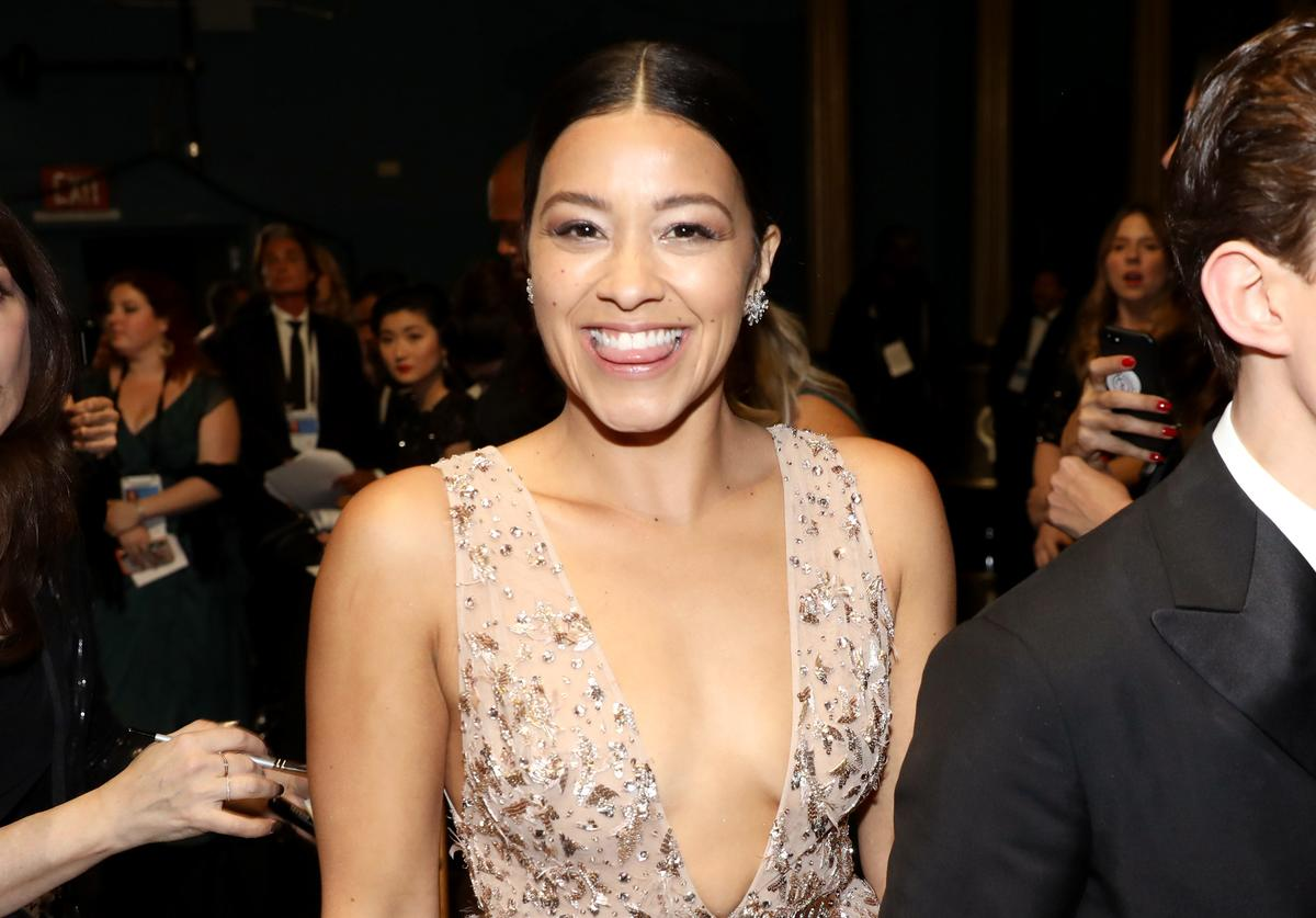 Gina Rodriguez (L) and Tom Holland attend the 90th Annual Academy Awards at the Dolby Theatre on March 4, 2018 in Hollywood, California.