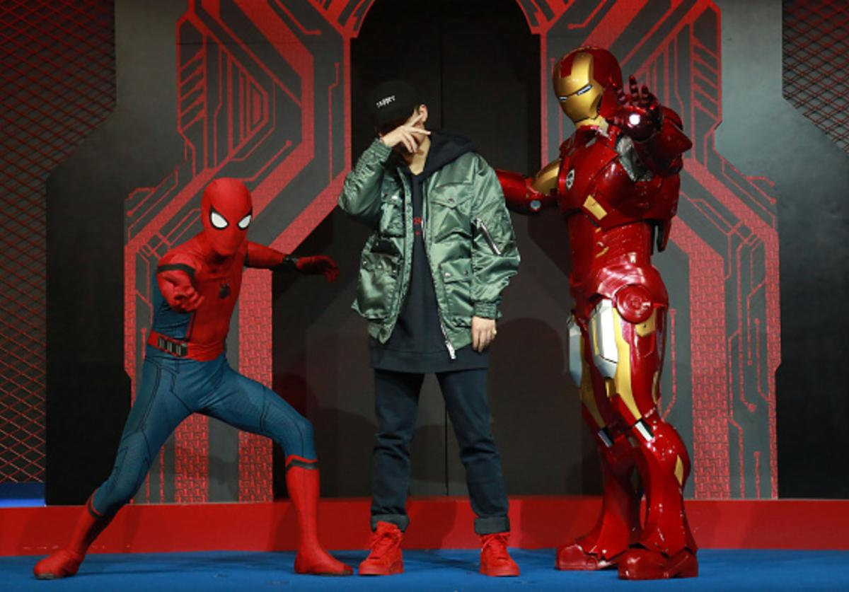 This photo taken on September 4, 2017 shows Chinese rapper PG One (C) performing during a promotional event for the movie 'Spiderman: Homecoming' in Beijing.