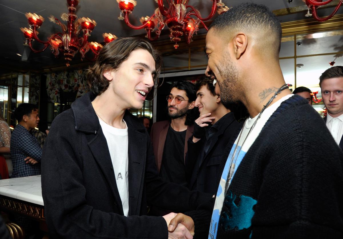 Timothee Chalamet and Kid Cudi attend GQ and Oliver Peoples Celebrate Timothee Chalamet March Cover Dinner at Nomad Los Angeles on February 20, 2018 in Los Angeles, California