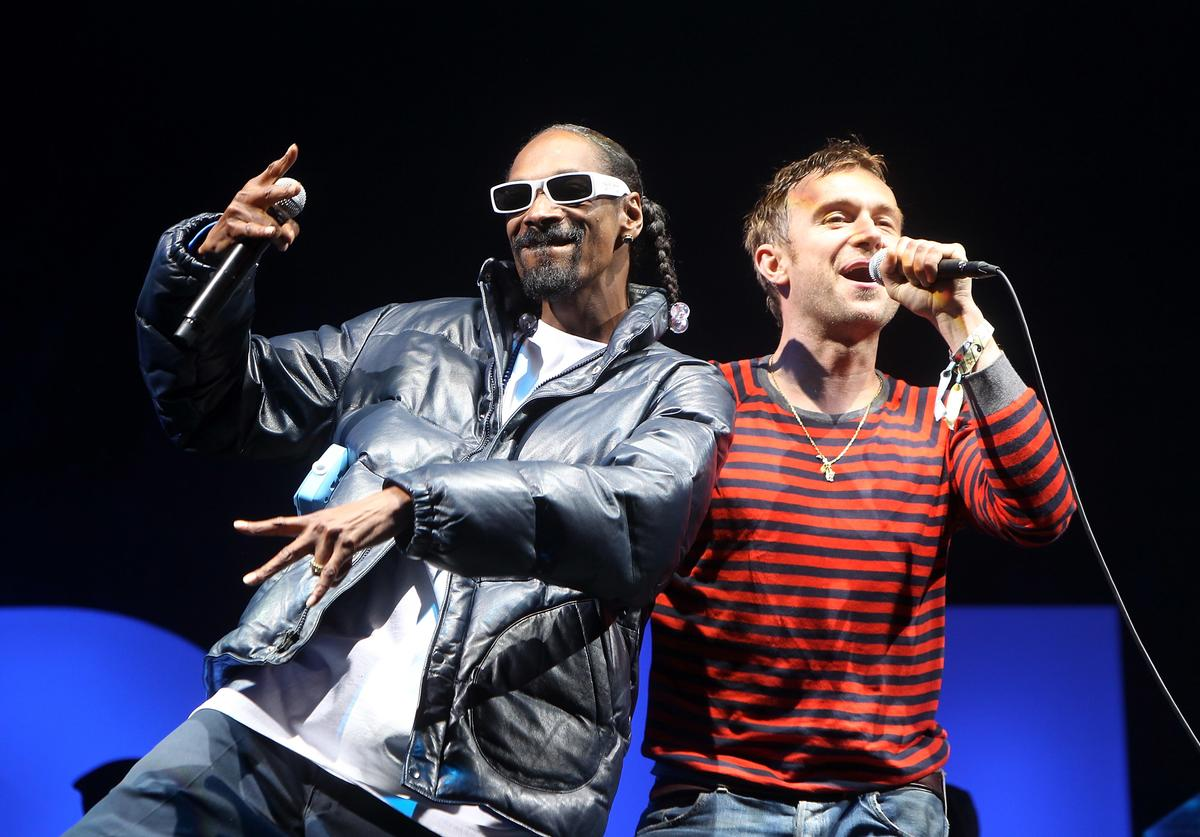Snoop Dog (L) performs with Damon Albarn of Gorillaz on the Pyramid Stage at Glastonbury Festival 2010 on June 25, 2010 in Glastonbury, England.