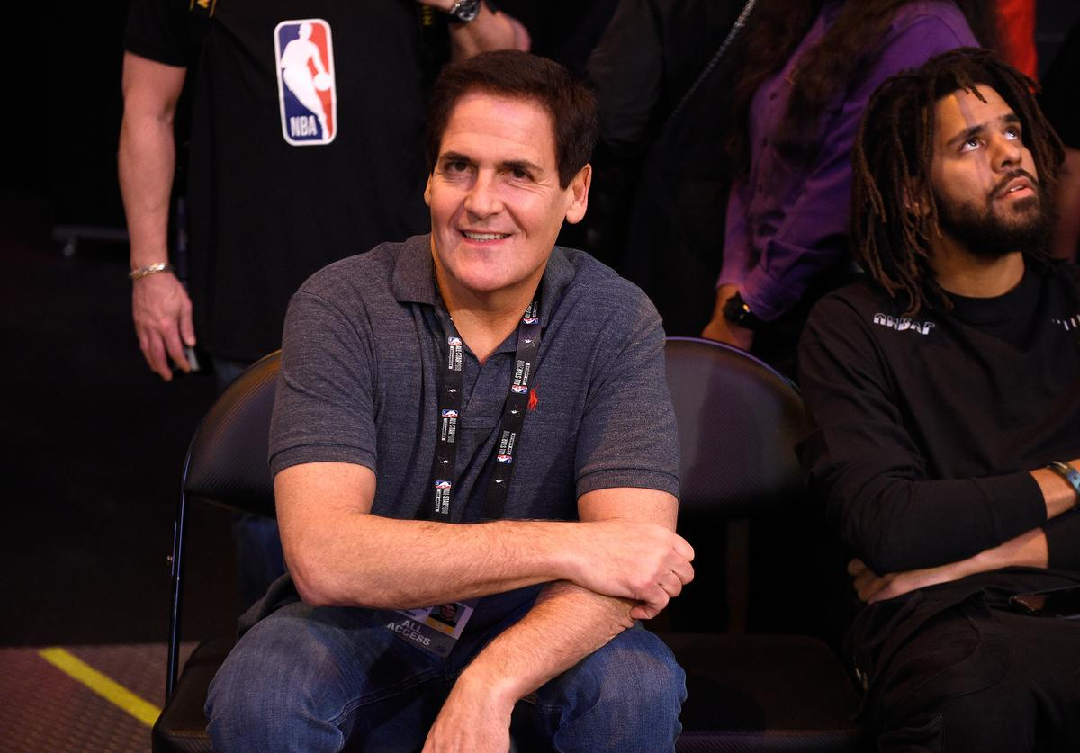 Dallas Mavericks owner Mark Cuban and J. Cole attend the 2018 JBL Three-Point Contest at Staples Center on February 17, 2018 in Los Angeles, California.