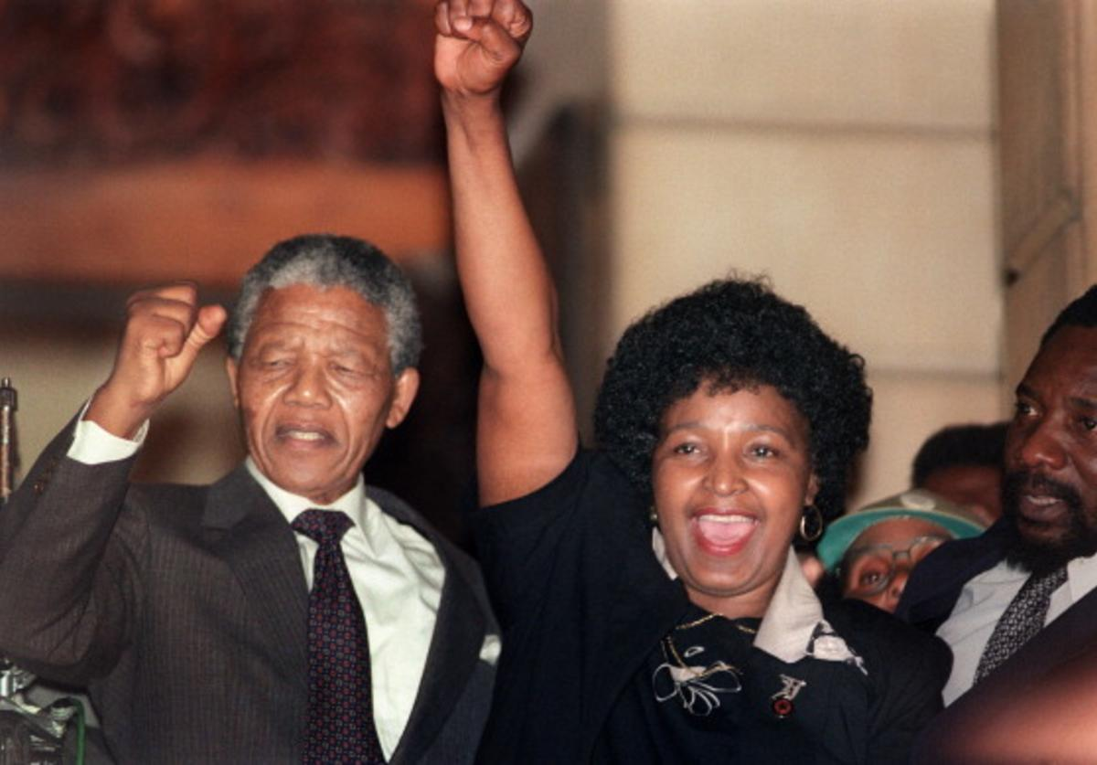 Anti-apartheid leader and African National Congress (ANC) member Nelson Mandela (L) and his then-wife Winnie raise their fists 11 February 1990 in Paarl to salute cheering crowd upon Mandela's release from Victor Verster prison.