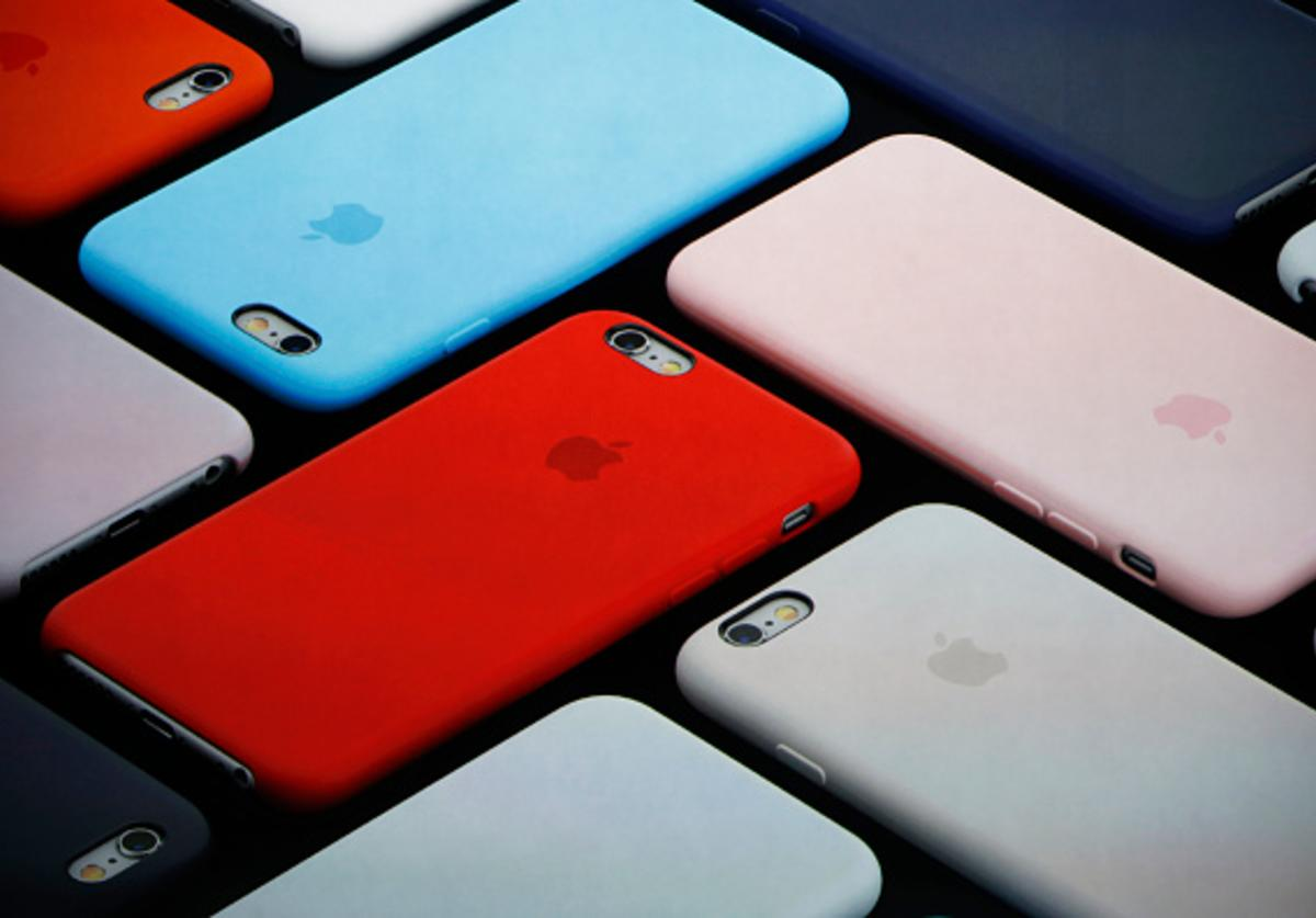 New iPhone covers are displayed on screen during a Special Event at Bill Graham Civic Auditorium September 9, 2015 in San Francisco, California.