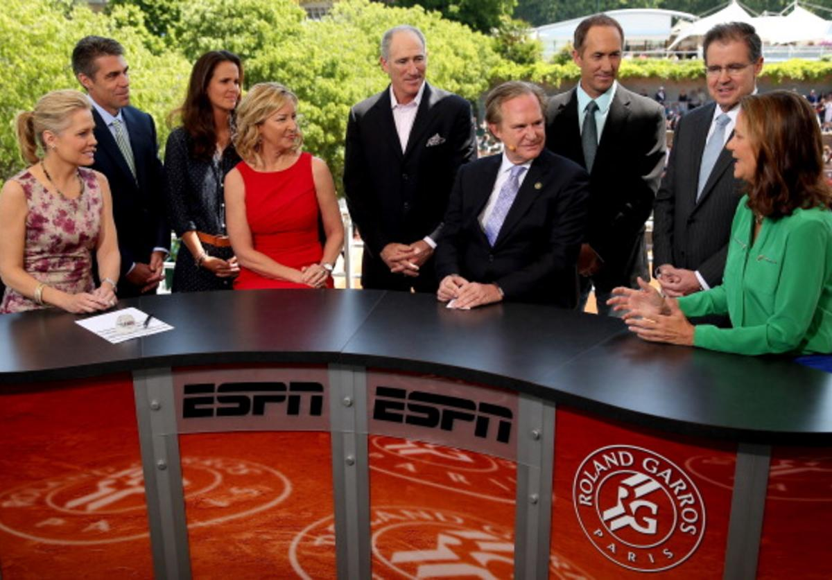 Chris McKendry, Chris Fowler, Mary Joe Fernandez, Brad Gilbert, International Hall of Fame Chaiman Chris Clouser Darren Cahill and International Hall of Fame President Stan Stenning listen as Pam Shriver talks about Chris Evert after she received a ring commeration her induction into the International Tennis Hall of Fame on the set of ESPN during day ten of the French Open at Roland Garros on June 4, 2013 in Paris, France