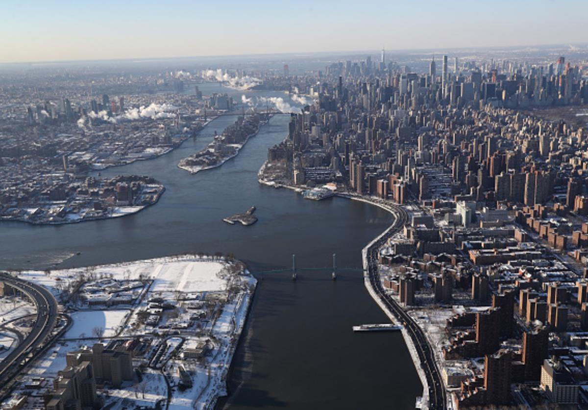 Manhattan and the Queens boroughs bisected by the East River lie under a blanket of snow on January 5, 2018 in New York City. Under frigid temperatures, New York City dug out from the 'Bomb Cyclone.'