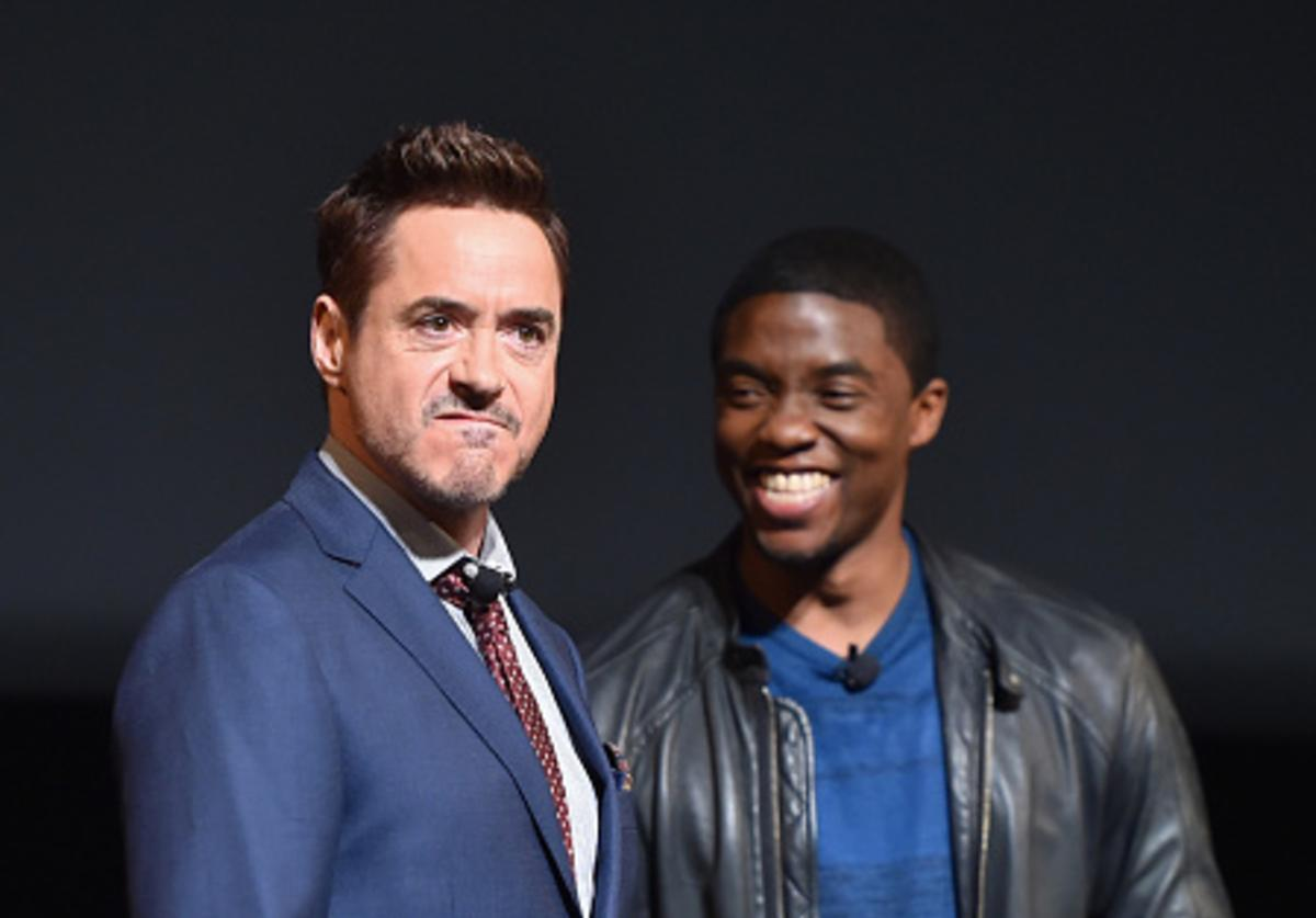 Actors Robert Downey Jr. (L) and Chadwick Boseman onstage during Marvel Studios fan event at The El Capitan Theatre on October 28, 2014 in Los Angeles, California.