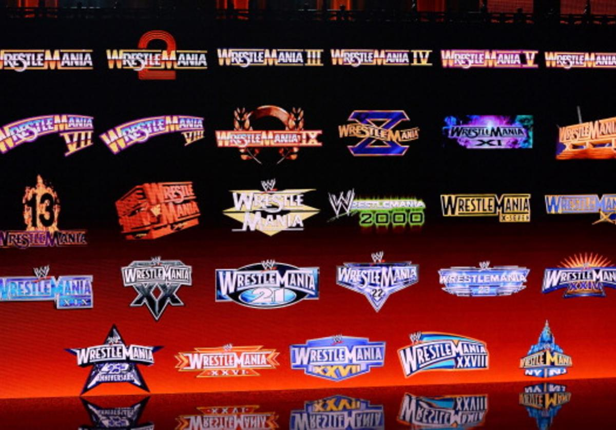 WrestleMania logos from past years are displayed on a screen during a news conference announcing the WWE Network at the 2014 International CES at the Encore Theater at Wynn Las Vegas on January 8, 2014 in Las Vegas, Nevada.