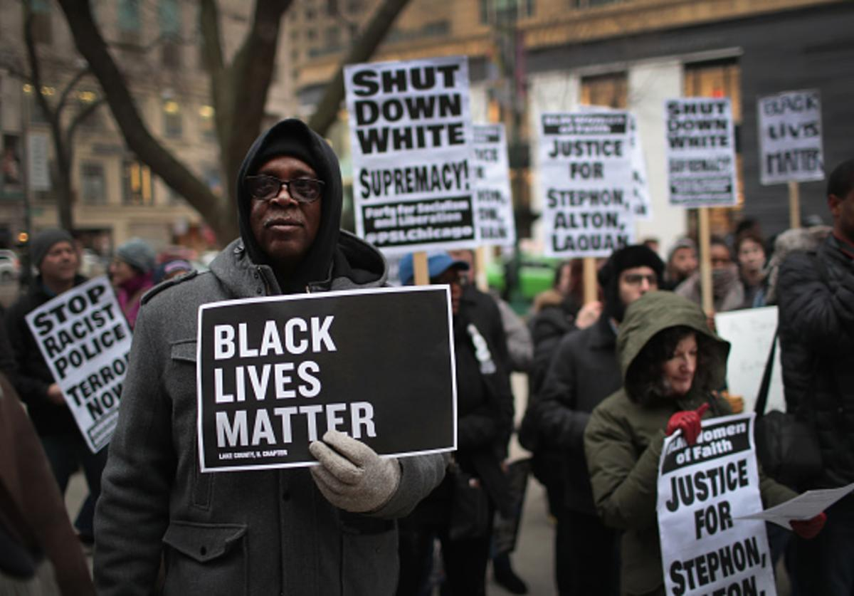 In recognition of the 50th anniversary of the death of Dr. Martin Luther King Jr., and in solidarity with the family and supporters of Stephon Clark and others killed by police, demonstrators protest and march in the Magnificent Mile shopping district on April 2, 2018 in Chicago, Illinois. Dr. King was killed on April 4, 1968.