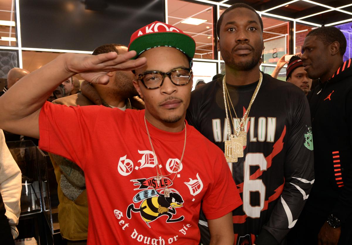Rappers T.I. and Meek Mill make a special appearance at The PUMA Lab Powered by Foot Locker at Foot Locker at the Gallery at South Dekalb Mall on February 6, 2014 in Atlanta, Georgia.