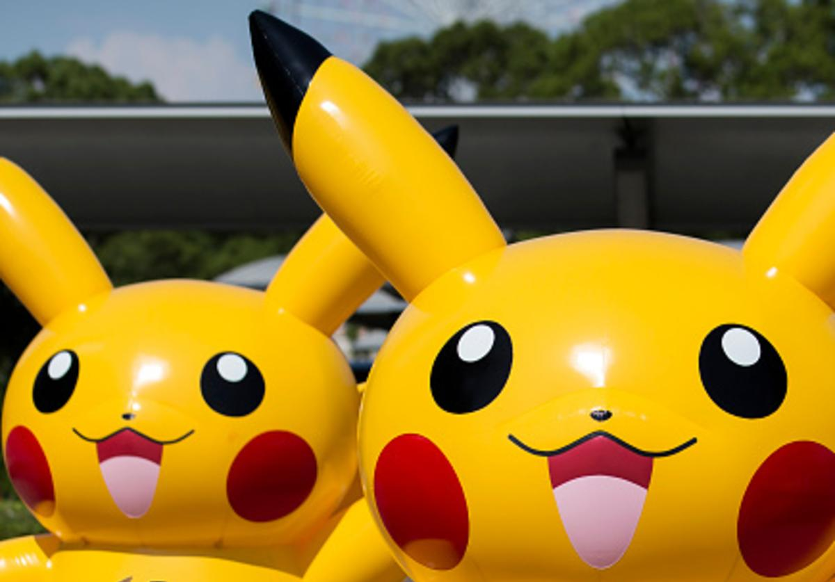 A girl walks past balloons of Pikachu, a character from Pokemon series game titles, during the Pikachu Outbreak event hosted by The Pokemon Co. on August 9, 2017 in Yokohama, Kanagawa, Japan.