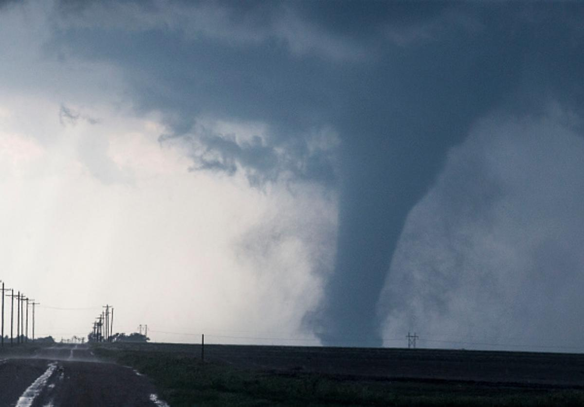 A tornado is seen South of Dodge City, Kansas moving North on May 24, 2016 in Dodge City, Kansas