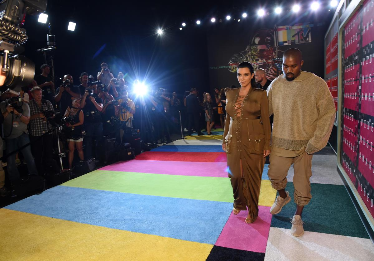Kanye West and TV personality Kim Kardashian attend the 2015 MTV Video Music Awards at Microsoft Theater on August 30, 2015 in Los Angeles, California