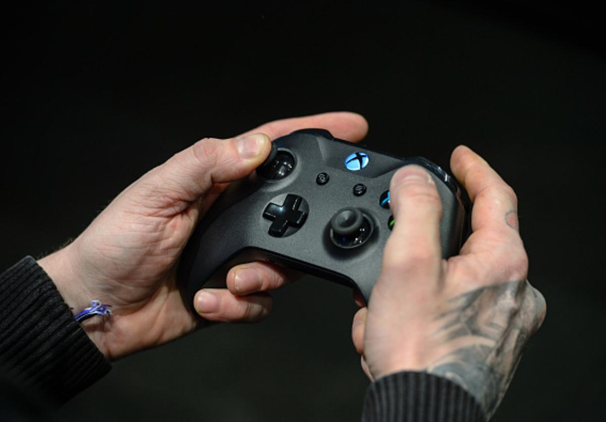 A participant holds a games controller to play a video game at the 2018 DreamHack video gaming festival on January 27, 2018 in Leipzig, Germany.