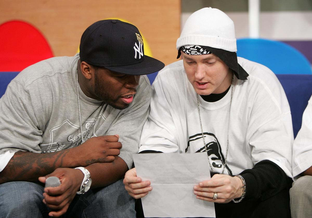 50 Cent (L) and Eminem appear onstage during BET's 106 & Park December 4, 2006 in New York City