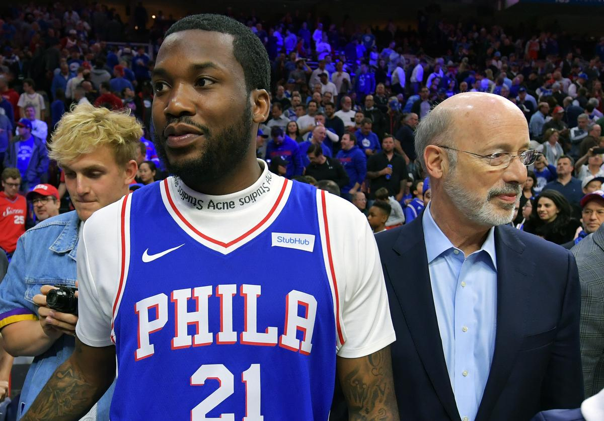 Entertainer Meek Mill stands with Pennsylvania Governor Tom Wolf during halftime between the Philadelphia 76ers and Miami Heat at Wells Fargo Center on April 24, 2018 in Philadelphia, Pennsylvania.