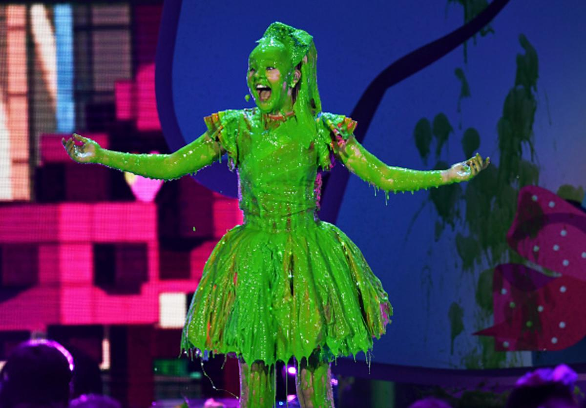 JoJo Siwa gets slimed onstage at Nickelodeon's 2018 Kids' Choice Awards at The Forum on March 24, 2018 in Inglewood, California.
