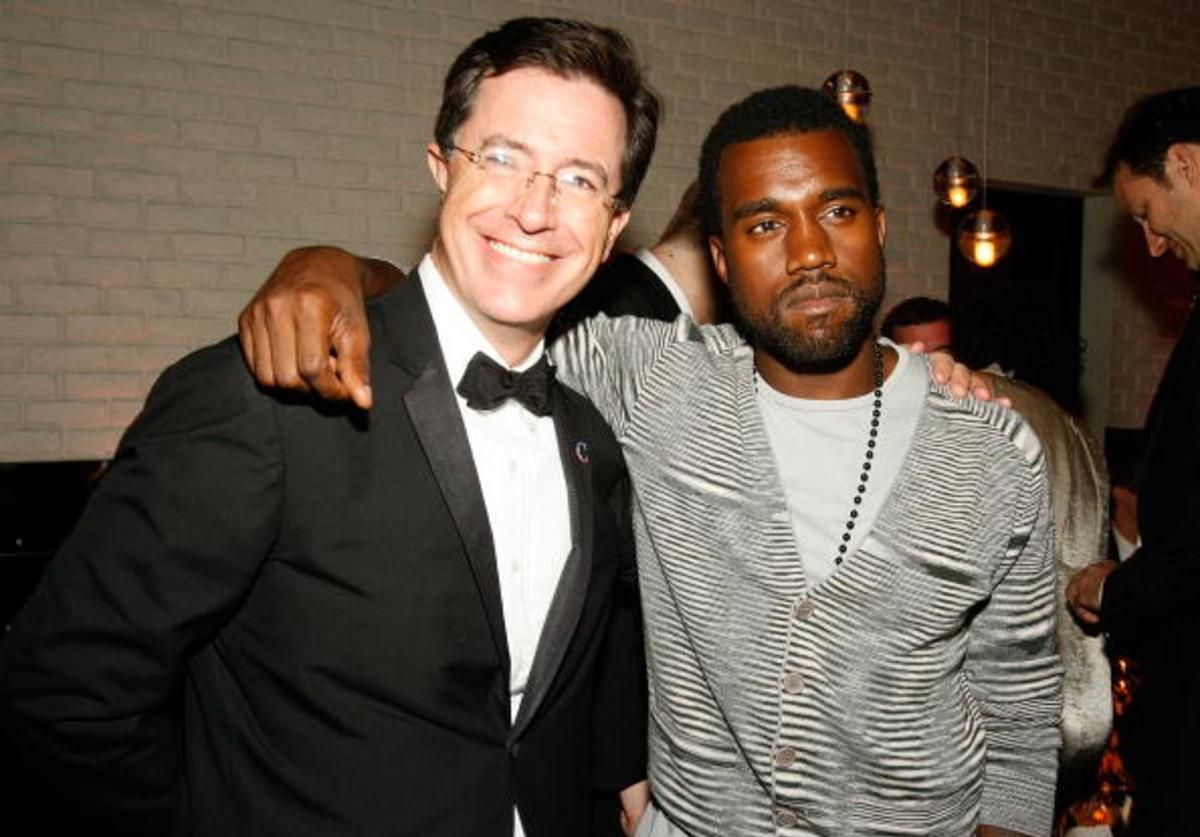 Talk show host Stephen Colbert (L) and rapper Kayne West attend the Comedy Central Emmy Awards party at the STK restaurant September 21, 2008 in Los Angeles, California.