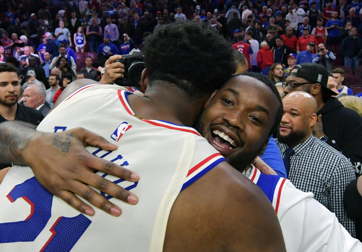 Joel Embiid #21 of the Philadelphia 76ers hugs entertainer Meek Mill after the game against the Miami Heat at Wells Fargo Center on April 24, 2018 in Philadelphia, Pennsylvania. The 76ers won 104-91.