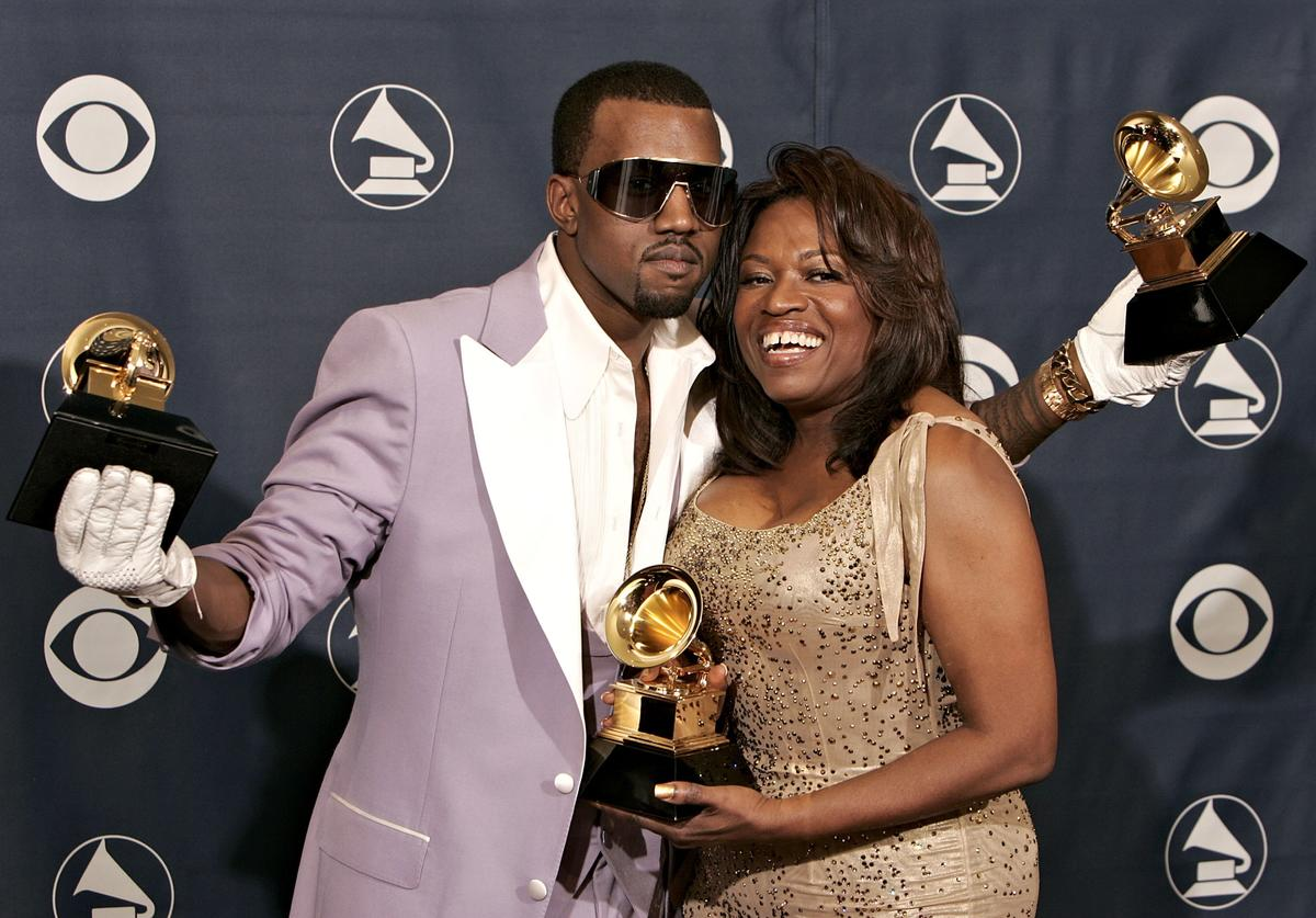 Kanye West with his awards for Best Rap Song, Best Rap Solo Performance and Best Rap Album with his mother Donda West pose in the press room at the 48th Annual Grammy Awards at the Staples Center on February 8, 2006 in Los Angeles, California