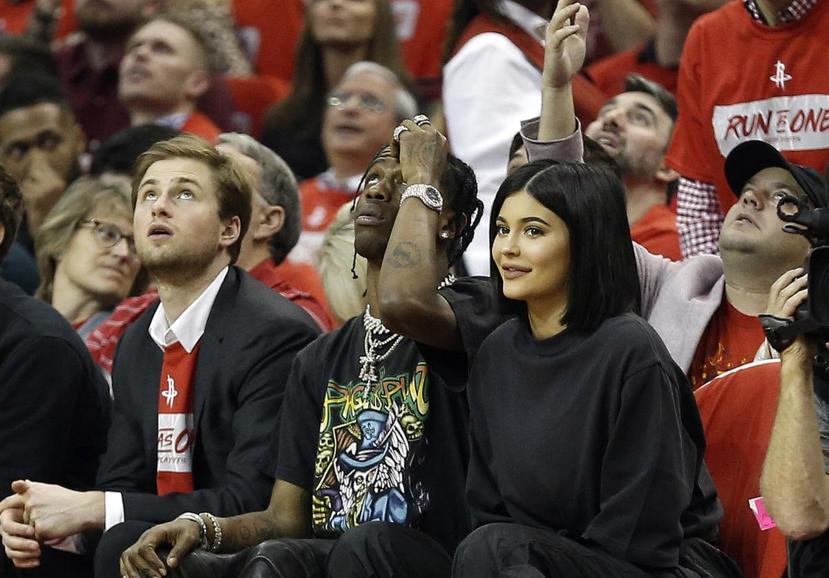 Travis Scott and Kylie Jenner watch from court side during Game Two of the first round of the Western Conference playoffs at Toyota Center on April 18, 2018 in Houston, Texas