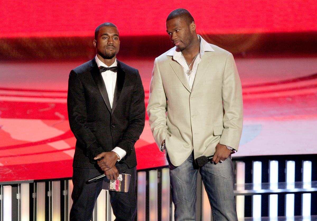 Rappers Kanye West (L) and 50 Cent present the 'Most Earth-Shattering Collaboration' award on stage during the 2007 MTV Video Music Awards held at The Palms Hotel and Casino on September 9, 2007 in Las Vegas, Nevada.