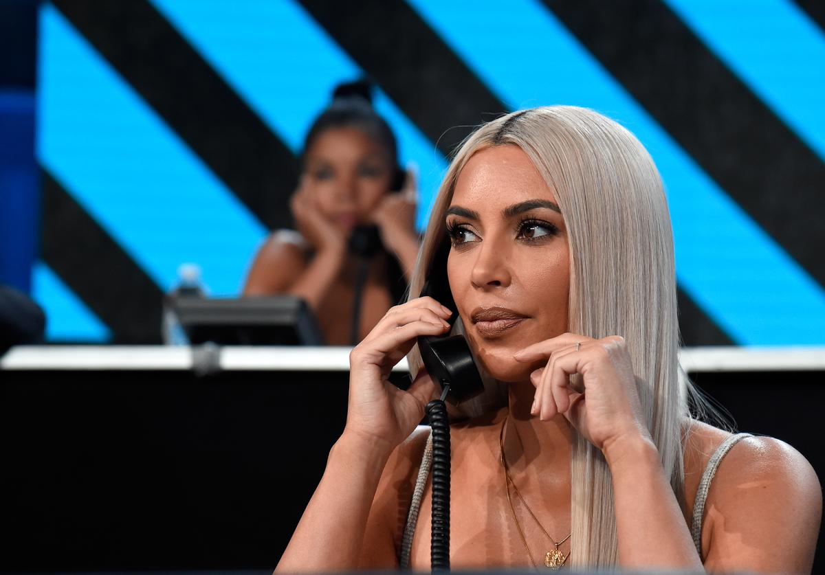 In this handout photo provided by One Voice: Somos Live!, Kim Kardashian participates in the phone bank onstage during 'One Voice: Somos Live! A Concert For Disaster Relief' at the Universal Studios Lot on October 14, 2017 in Los Angeles, California.