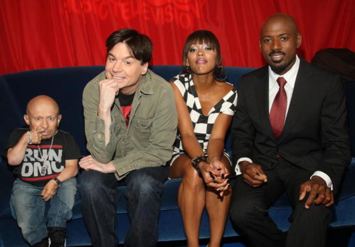 Actors Verne Troyer, Mike Myers, Megan Good, and Romany Malco pose backstage at MTV's TRL at MTV Studios June 17, 2008 in New York City.