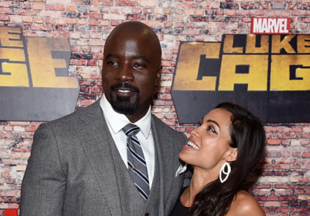 Mike Colter and Rosario Dawson attend the 'Luke Cage' New York Premiere at AMC Magic Johnson Harlem on September 28, 2016 in New York City.