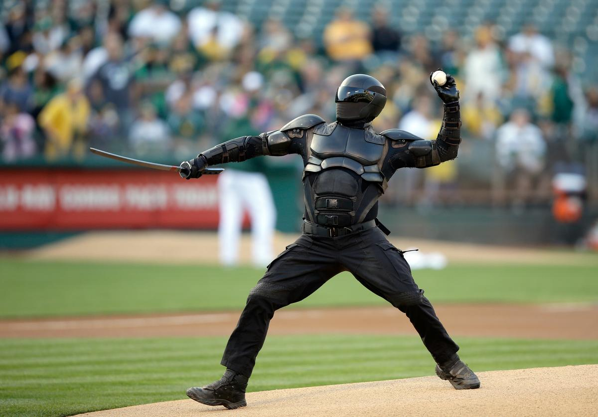 Snake Eyes from the GI Joe movie throws out the ceremonial first pitch before the the Oakland Athletics game against the Toronto Blue Jays at O.co Coliseum on July 30, 2013 in Oakland, California.
