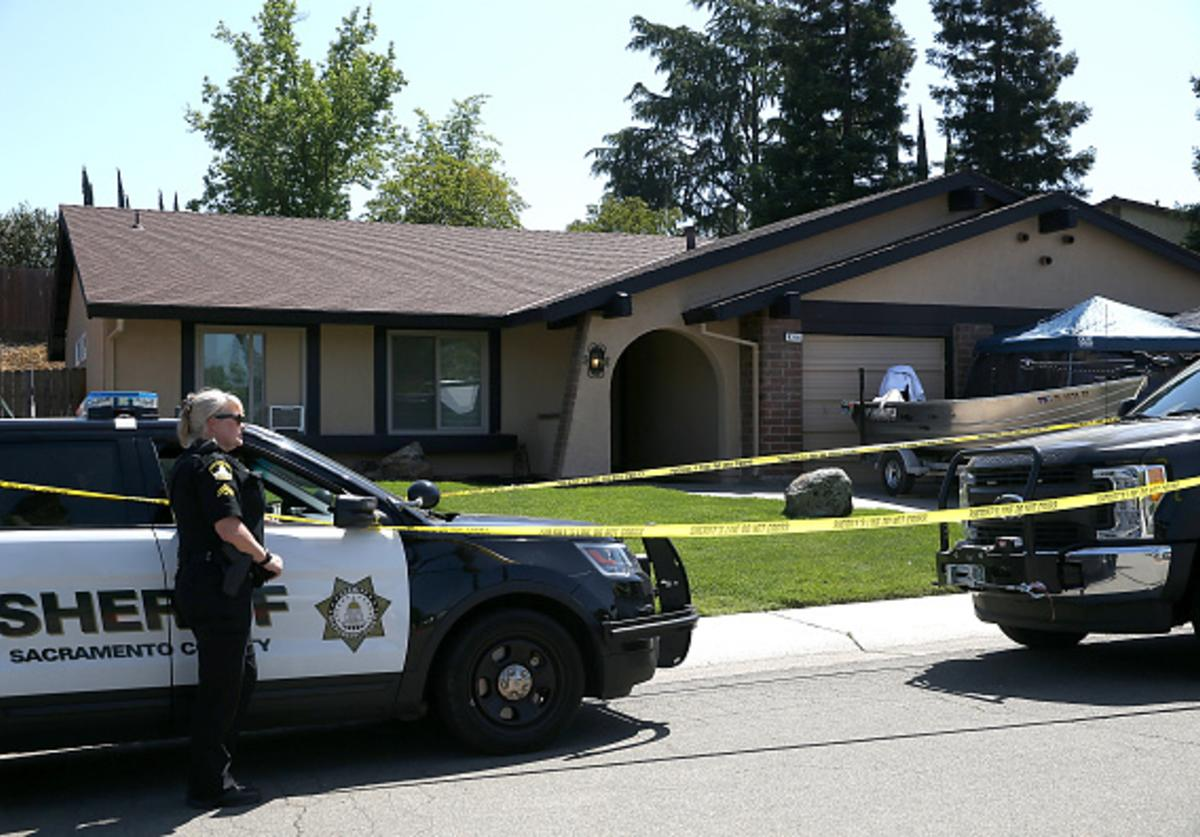 A Sacramento County sheriff deputy stands guard in front of the home of accused rapist and killer Joseph James DeAngelo on April 24, 2018 in Citrus Heights, California.