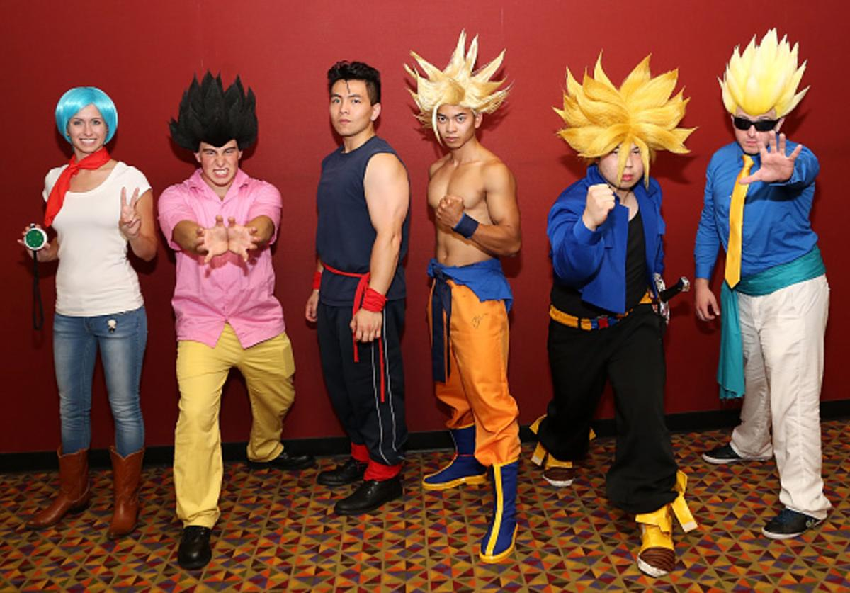 Guests dressed as characters from the movie pose for a photo at the 'Dragon Ball Z: Resurrection 'F'' New York theatrical premiere at AMC Empire on August 3, 2015 in New York City