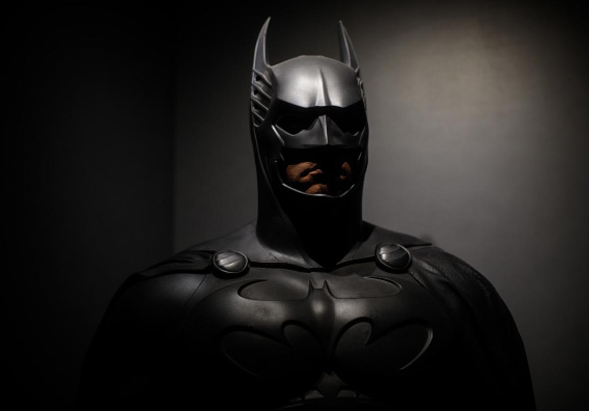 A Batman costume from the 1995 Batman Forever film worn by Val Kilmer and designed by Rob Ringwood and Ingrid Ferrin is on display at the DC Comics Exhibition: Dawn Of Super Heroes at the O2 Arena on February 22, 2018 in London, England.
