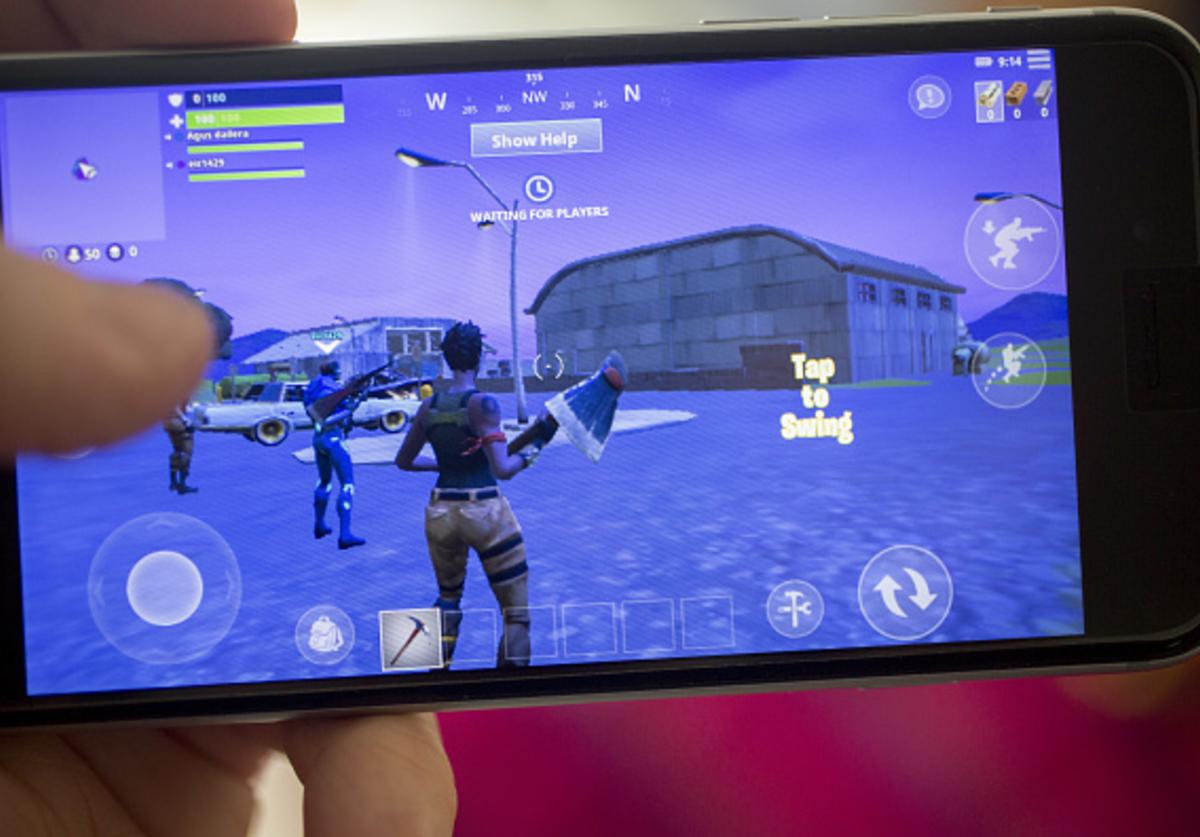 Battle Royale video game is displayed for a photograph on an Apple Inc. iPhone in Washington, D.C., U.S., on Thursday, May 10, 2018.