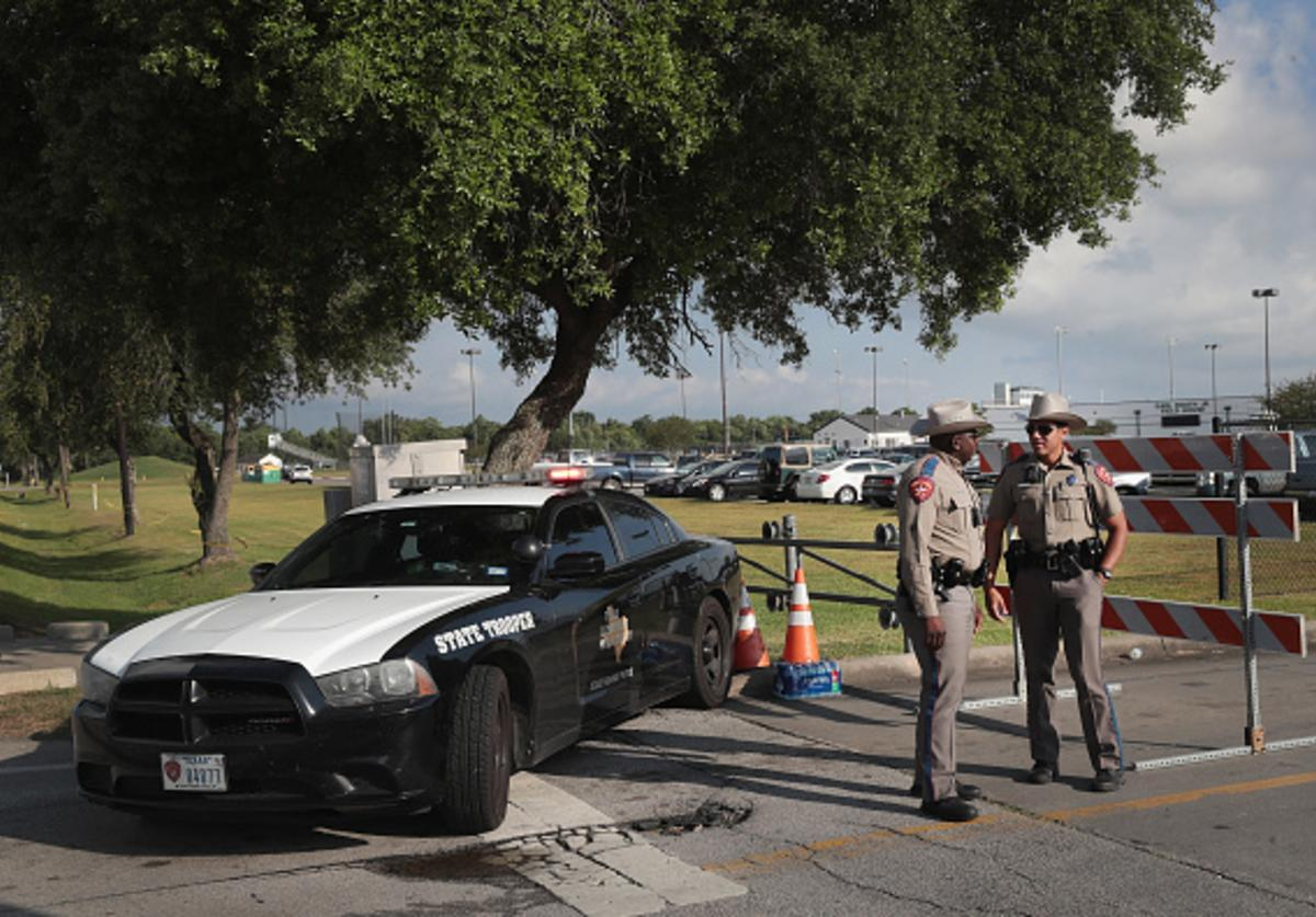 Police stand guard outside of Santa Fe High School on May 19, 2018 in Santa Fe, Texas. Yesterday morning 17-year-old student Dimitrios Pagourtzis entered the school with a shotgun and a pistol and opened fire, killing at least 10 people.