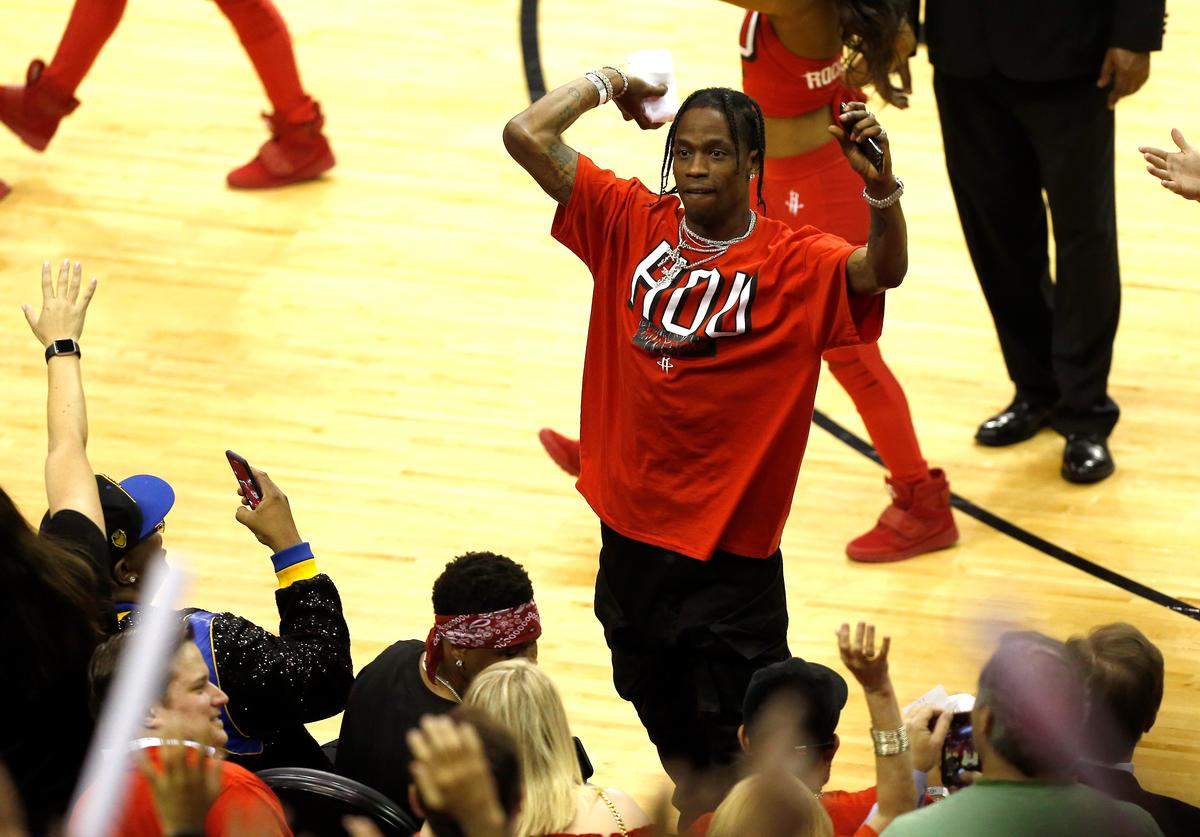Travis Scott throws a t-shirt in to the crowd in Game One of the Western Conference Finals of the 2018 NBA Playoffs between the Houston Rockets and the Golden State Warriors at Toyota Center on May 14, 2018 in Houston, Texas