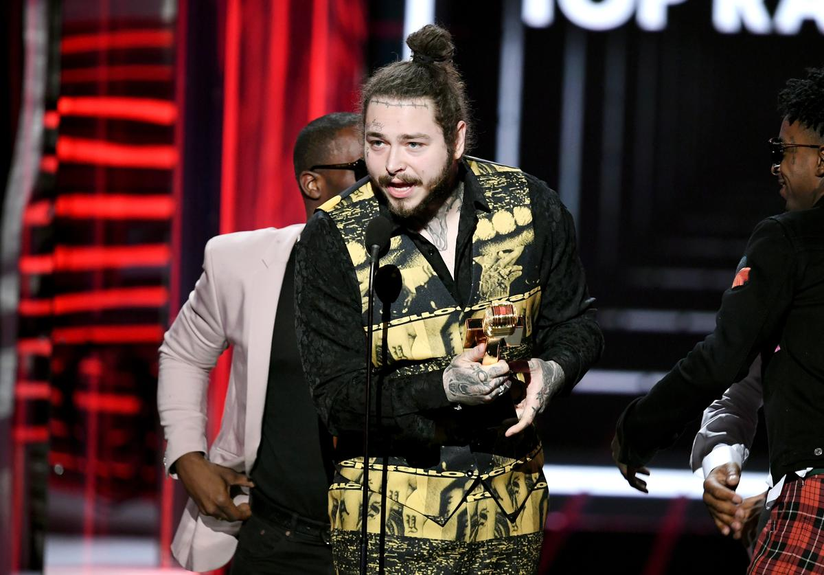 Post Malone accepts the Top Rap Song award for 'Rockstar' onstage during the 2018 Billboard Music Awards at MGM Grand Garden Arena on May 20, 2018 in Las Vegas, Nevada