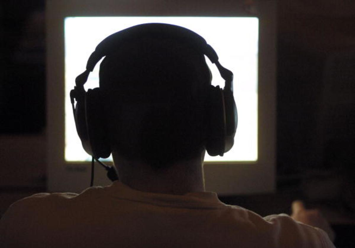A computer game enthusiast plays a computer game during a computer gaming summit May 3, 2003 in Osnabrueck, Germany.