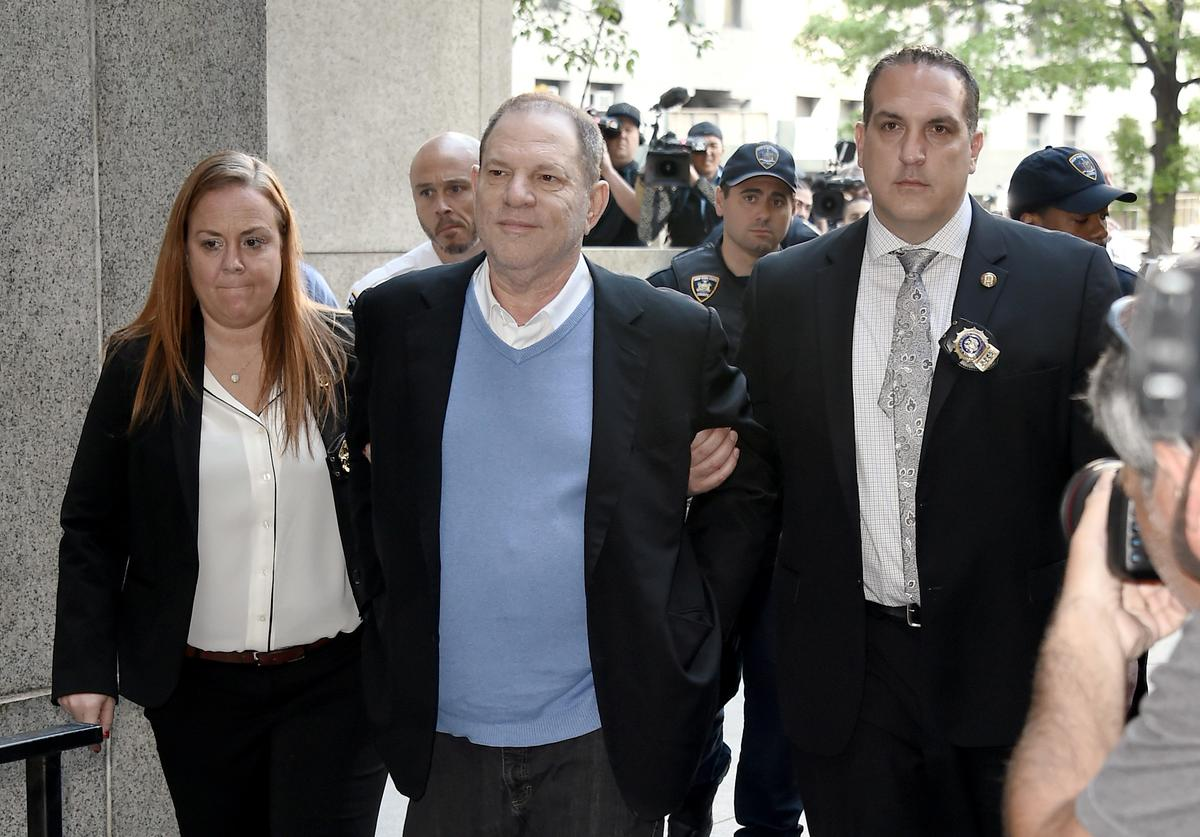 Harvey Weinstein arrives for arraignment at Manhattan Criminal Courthouse in handcuffs after being arrested and processed on charges of rape, committing a criminal sex act, sexual abuse and sexual misconduct on May 25, 2018 in New York City. The former movie producer faces charges in connection with accusations made by aspiring actress Lucia Evans who has said that Weinstein forced her to perform oral sex on him in his Manhattan office in 2004. Weinstein (66) has been accused by dozens of other women of forcing them into sexual acts using both pressure and threats. The revelations of the his behavior helped to spawn the global #MeToo movement.